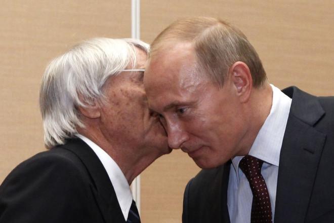 So close: Bernie Ecclestone and Vladimir Putin share a personal moment