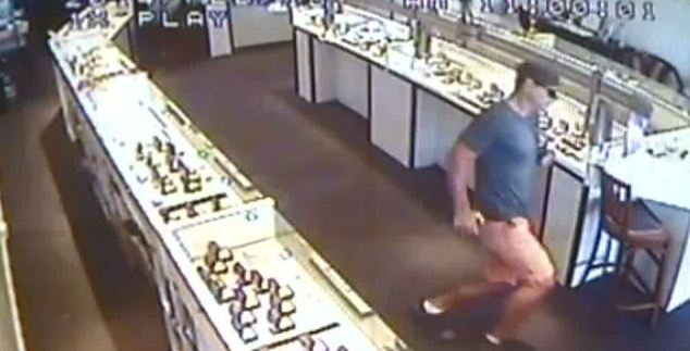 CCTV footage shows the thief fleeing the jewellers in Cairns, Queensland.
