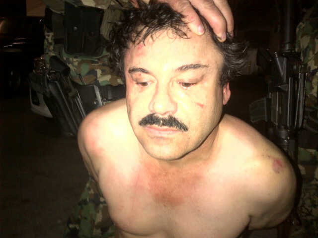 Photo of Guzman's arrest released by law enforcement agencies.