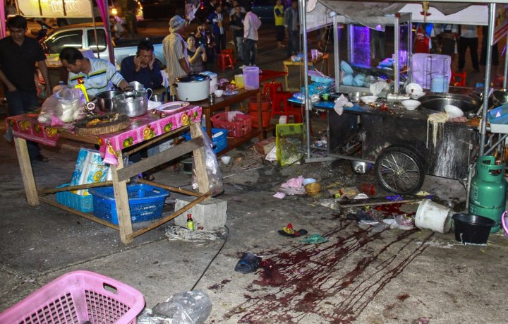 Blood stains are seen at the scene where an explosion took place near the anti-government protest site at Khao Saming district, in Trat province February 22, 2014.