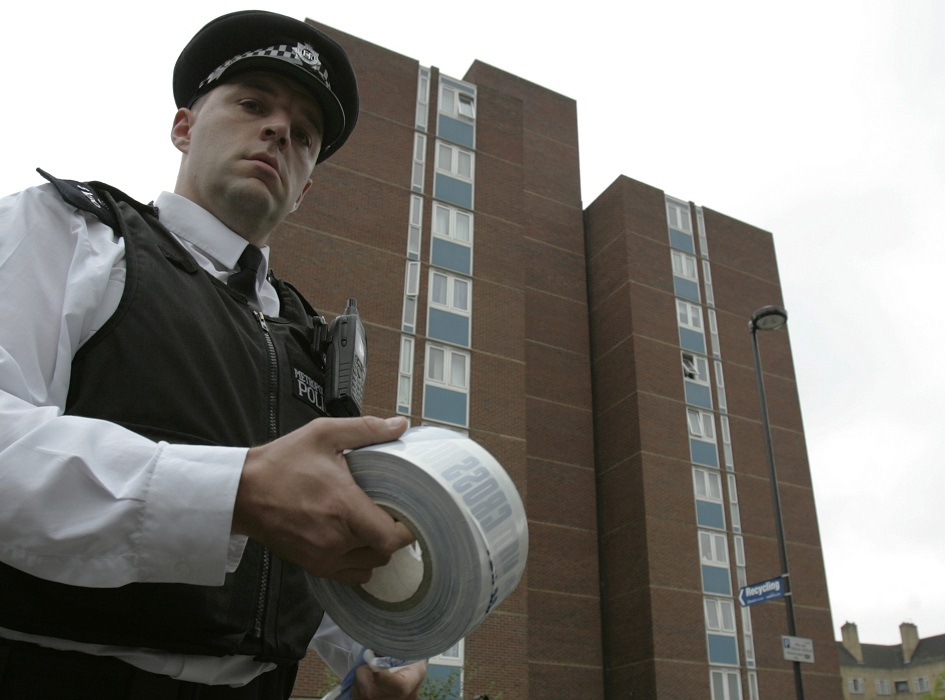 Policeman at a murder scene in south east London