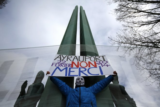 Farmers, ecologists and anarchists join together in a protest against the new French airport. The sign reads,