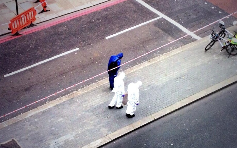 Police forensics officers at scene of fight in Bishopsgate, which cause delays around Liverpool Street station