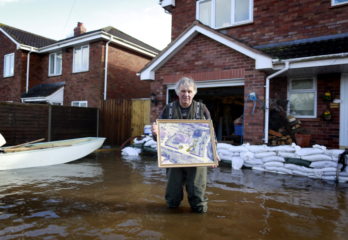 Flood Victims Out of Homes Until Christmas