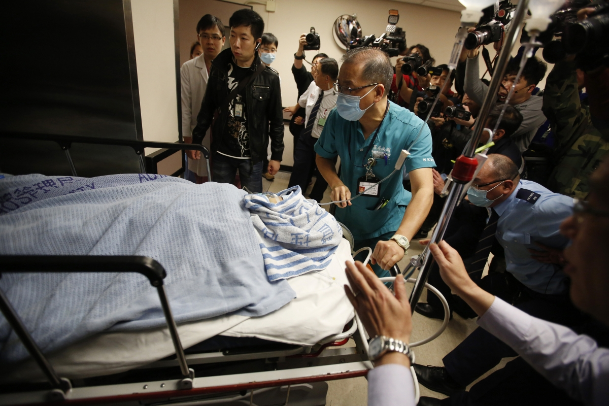 Former Ming Pao chief editor Kevin Lau Chun-to is wheeled into the operation theatre at a hospital in Hong Kong