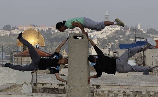 Palestinian youths practice their parkour skills in Jerusalem's Old City
