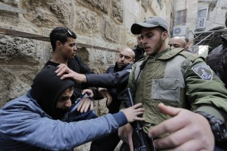 Israeli police and border police officers scuffle with a Palestinian who is trying to enter the compound known to Muslims as Noble Sanctuary and to Jews as Temple Mount in Jerusalem's Old City