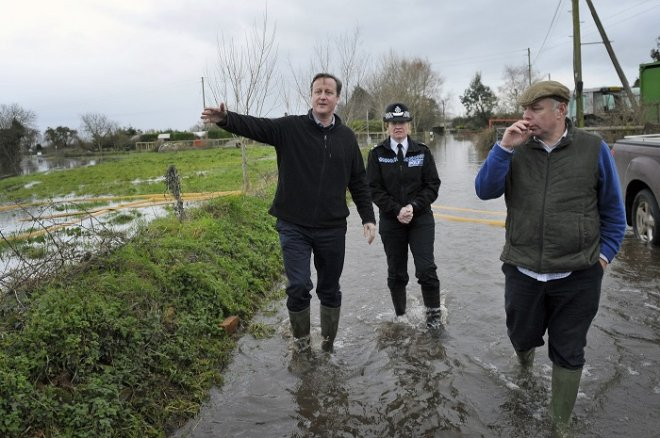 Prime Minister David Cameron announced a £10m package to help flood-hit businesses.