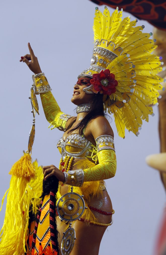 A reveller from the Tom Maios samba school takes part in the first night of the Special Group category of the annual Carnival parade in Sao Paulo's Sambadrome March 1, 2014.