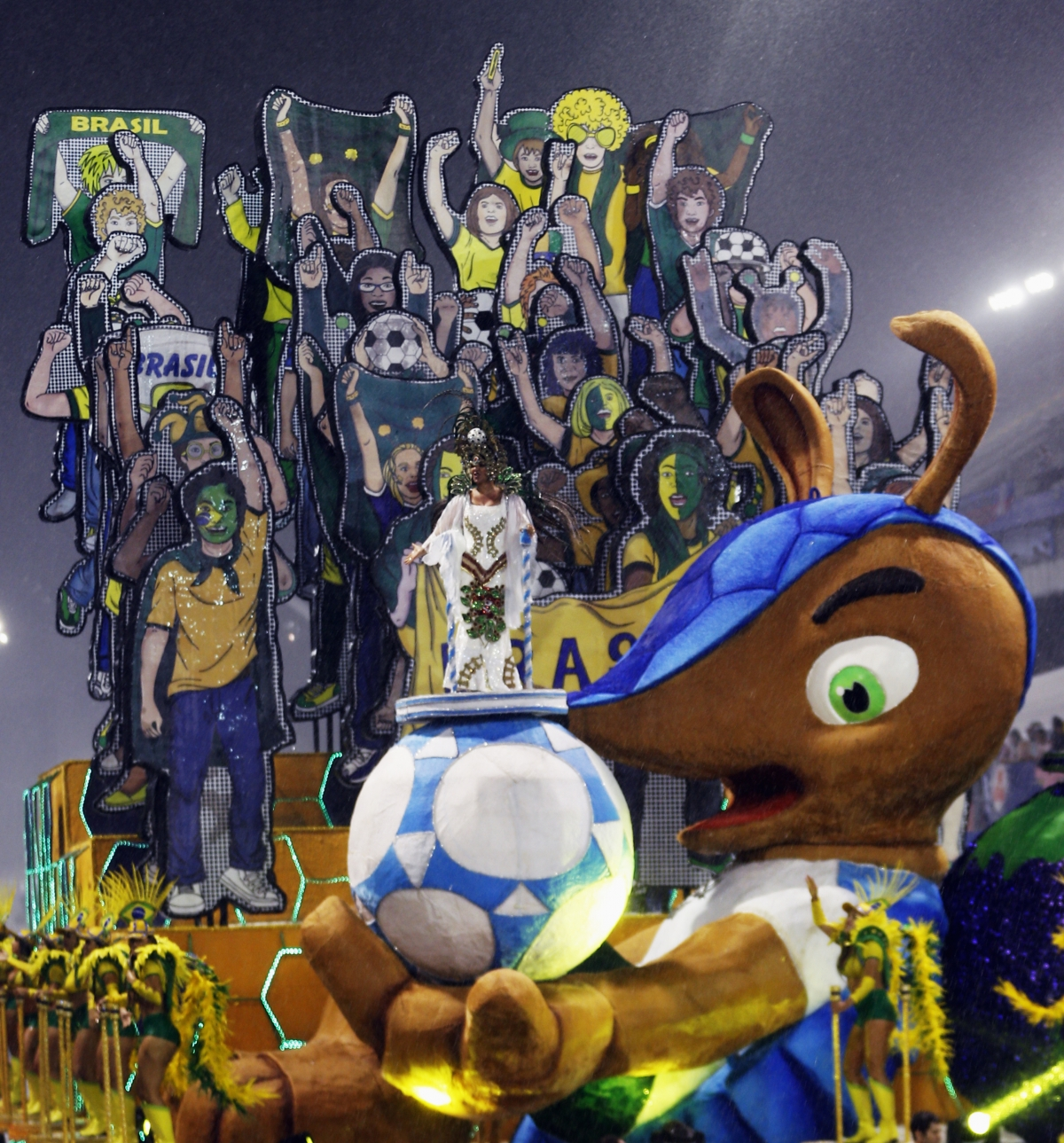 The official mascot of the FIFA 2014 World Cup, Fuleco the Armadillo, is seen in a float of Leandro de Itaquera samba school during the first night of the Special Group of the annual Carnival parade in Sao Paulo's Sambadrome February 28, 2014.