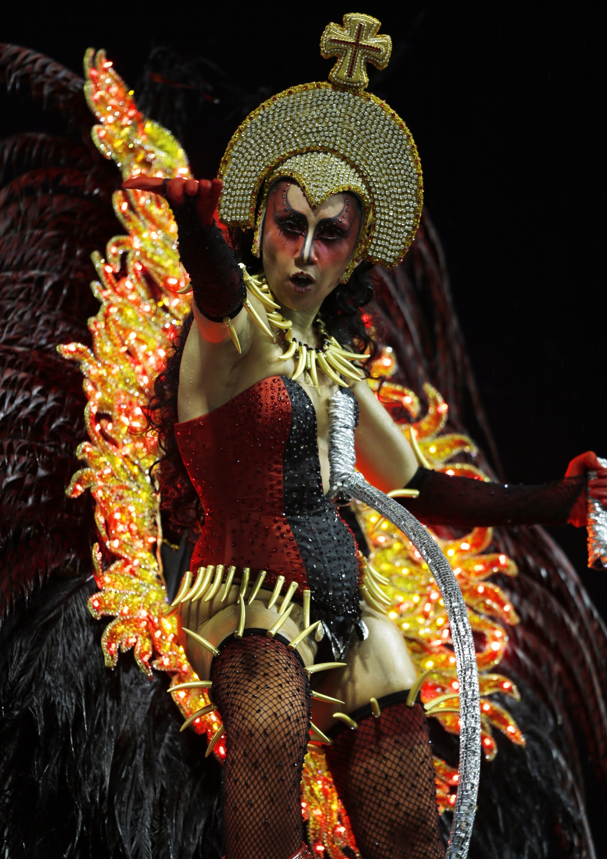 A reveller from the X9 samba school takes part in the first night of the Special Group of the annual Carnival parade in Sao Paulo's Sambadrome March 1, 2014.