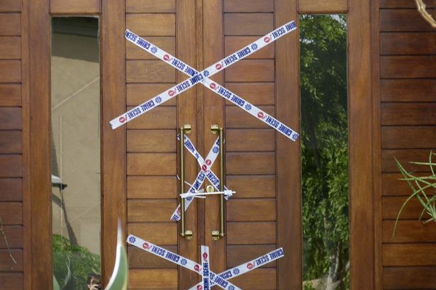 Police cordon off Oscar Pistorius's home in Pretoria, where he fatally shot Reeva Steenkamp in 2013.