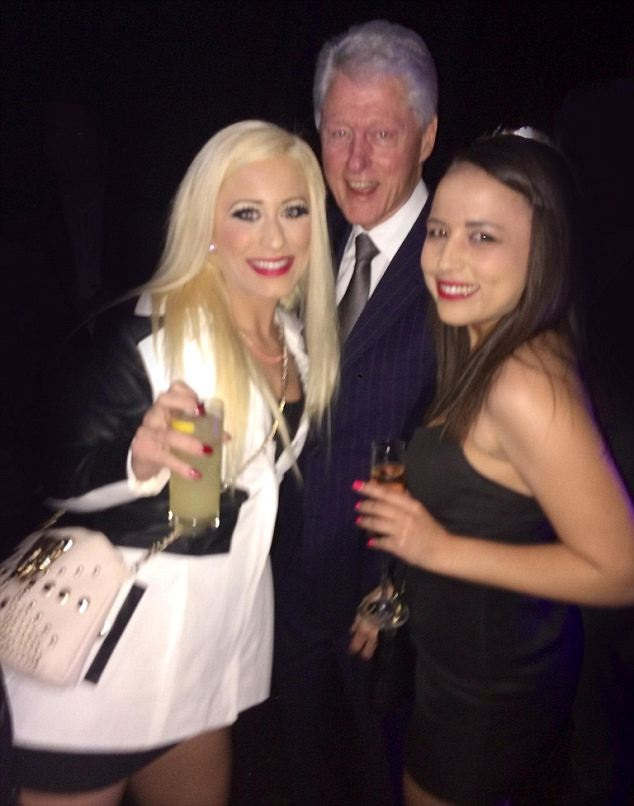 Former President Bill Clinton Poses For Selfie With Two