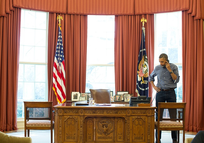 US President Barack Obama speaks on the phone with his Russian counterpart Vladimir Putin about escalating tensions in Ukraine.