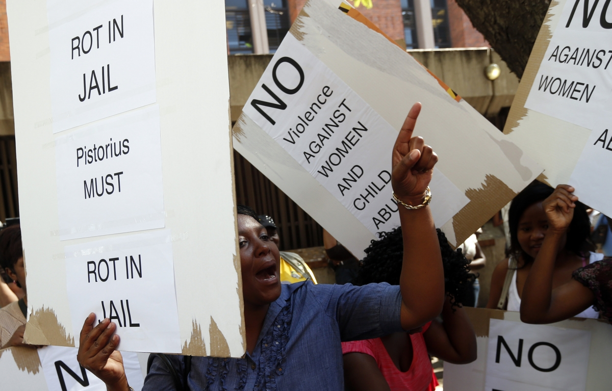 Women protest outside the Pretoria Magistrates court, during the bail application hearing of South African athlete Oscar Pistorius