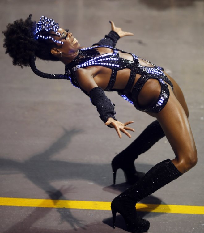 A reveller from the Vai Vai samba school takes part in the first night of the Special Group category of the annual Carnival parade in Sao Paulo's Sambadrome March 1, 2014.