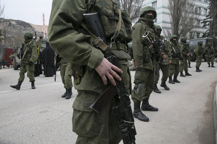 Armed troops stand guard near a Ukrainian border post in the Crimean town of Balaclava.