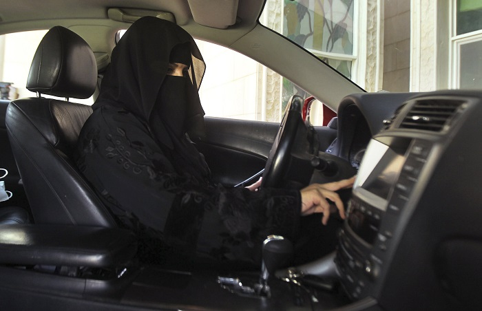 A Saudi woman takes part in a day of protest against the kingdom's ban on female drivers.