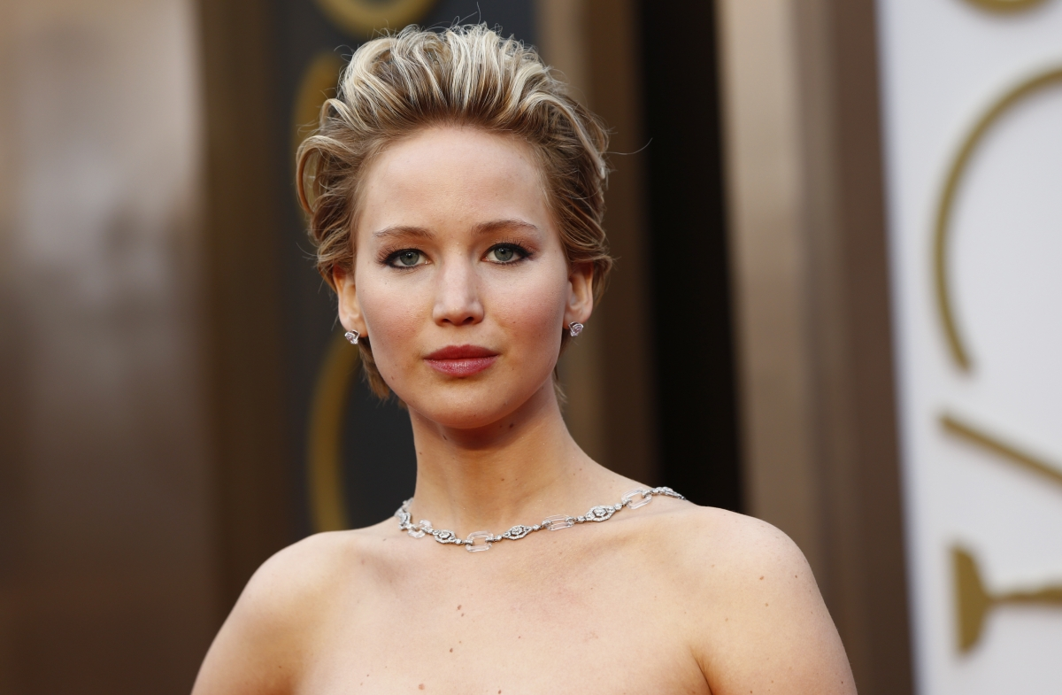 American actress Jennifer Lawrence stumbled and fell over her gown on the 2014 Oscars red carpet.
