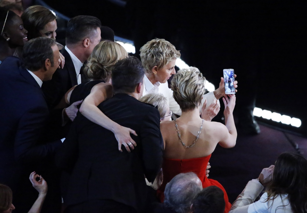 Host Ellen Degeneres takes a group picture at the 86th Academy Awards in Hollywood, California