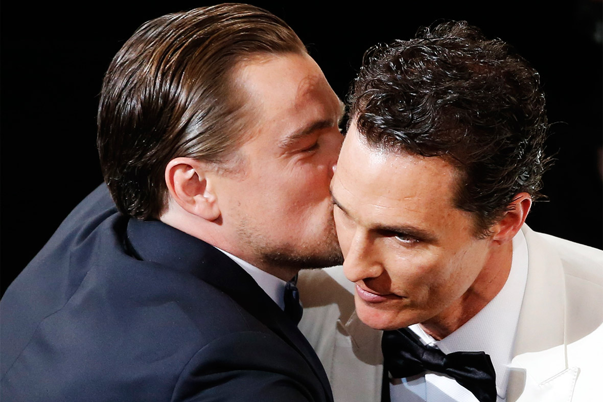 Matthew McConaughey is kissed by Leonardo DiCaprio upon winning the Best Actor prize for his role in Dallas Buyers Club.