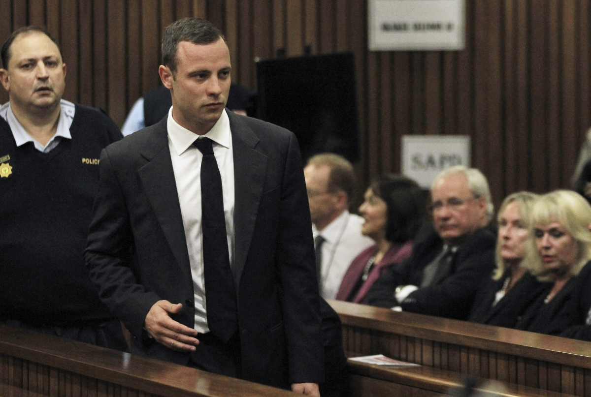 June Steenkamp watches Oscar Pistorius as Bladerunner takes a seat at his trial for killing Reeva Steenkamp