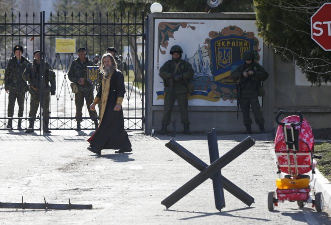 Russian troops patrol Ukranian army base in Crimea