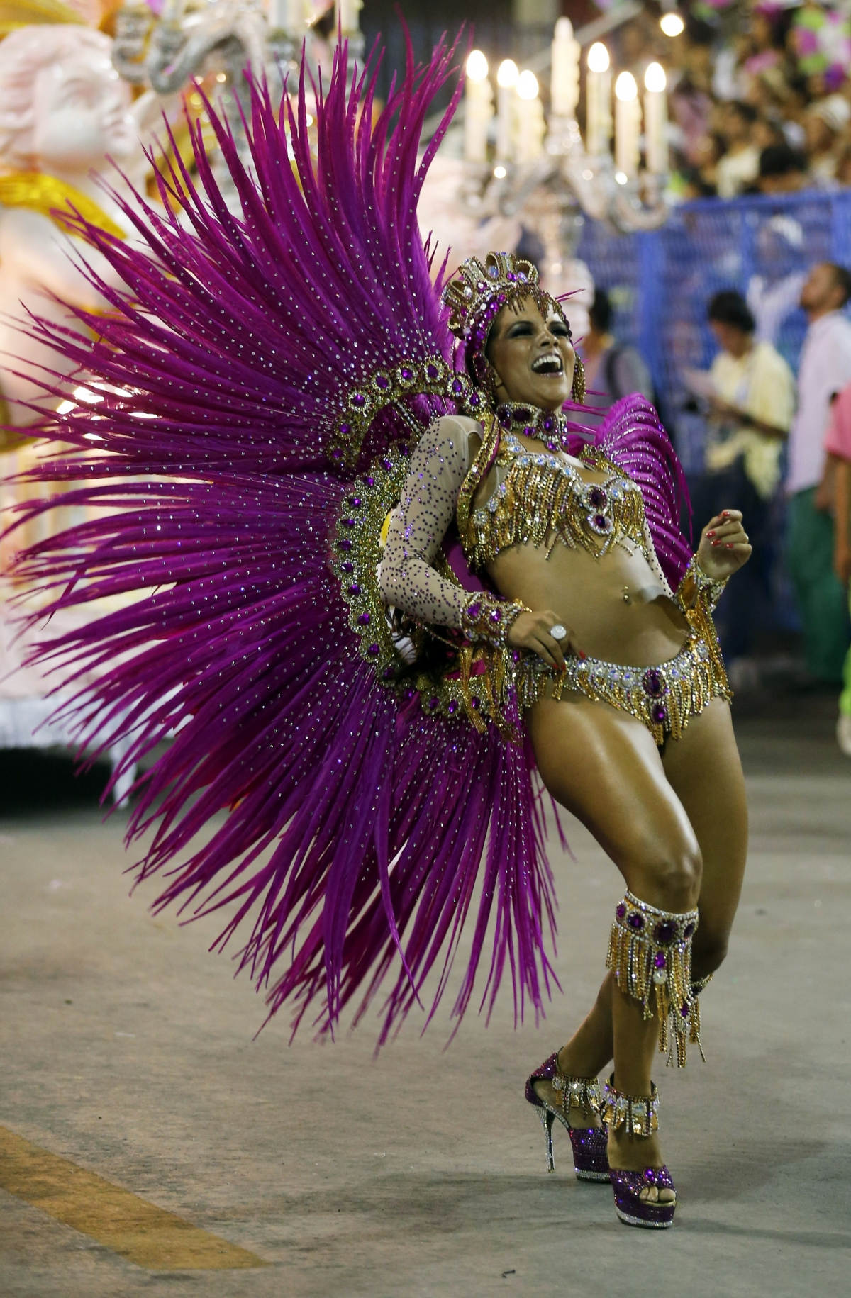A reveller of the Mangueira samba school participates in the annual Carnival parade in Rio de Janeiro's Sambadrome, March 3, 2014