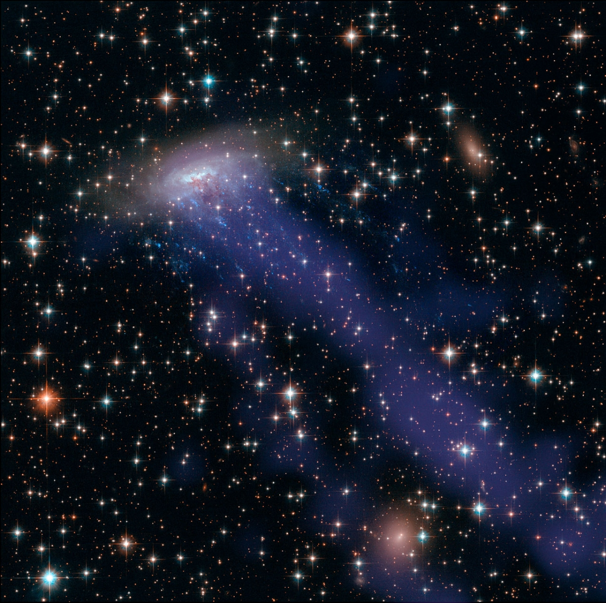 Hubble image ESO 137-001 galaxy being destroyed