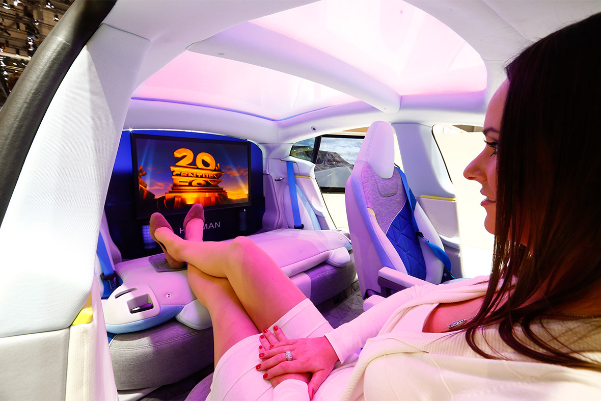 A model poses in the Rinspeed XchangE electric powered autonomous driving concept car