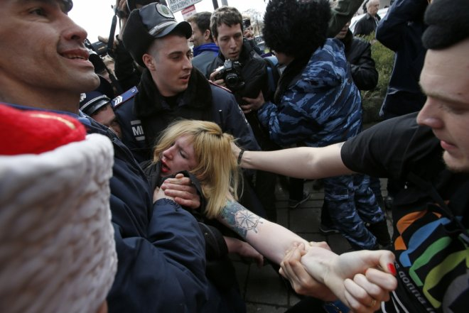 Femen protester is detained in Simferpol during protests against the annexation of the Crimea