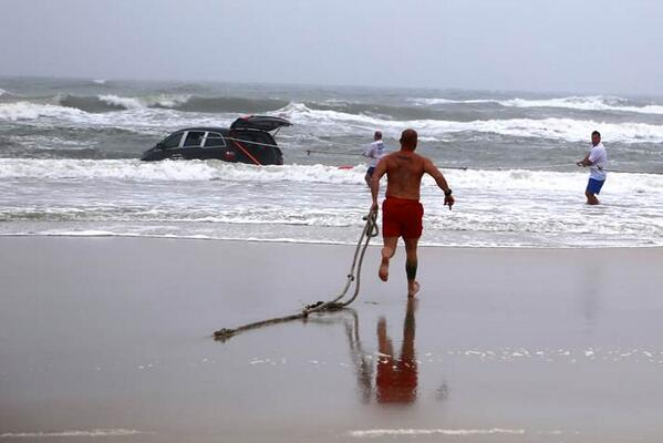 Lifeguard rushing to help the mother and children in a minivan in Daytona Beach.