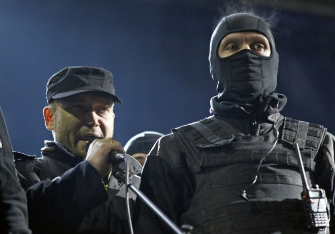 Dmytro Yarosh (L), a leader of the Right Sector movement, addresses during a rally in central Independence Square in Kiev