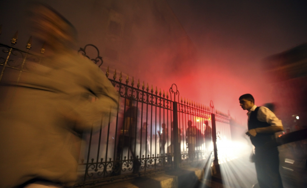 People flee from an explosion at an electricity plant at Al Hussien district in old Cairo May 22, 2012.