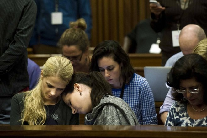 Aimee Pistorius leans on the shoulder of an unknown friend at the murder trial of her brother Oscar Pistorius for killing Reeva Steenkamp
