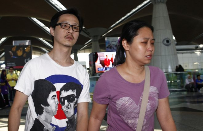 Family members of those onboard the missing Malaysia Airlines flight walk into the waiting area at Kuala Lumpur International Airport in Sepang March 8, 2014.