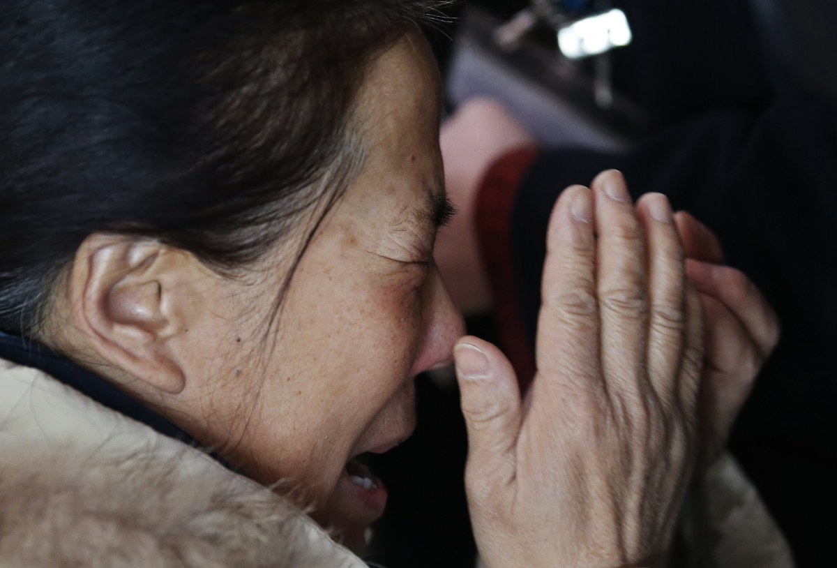 A relative of a passenger onboard Malaysia Airlines flight MH370 cries at the Beijing Capital International Airport in Beijing March 8, 2014.