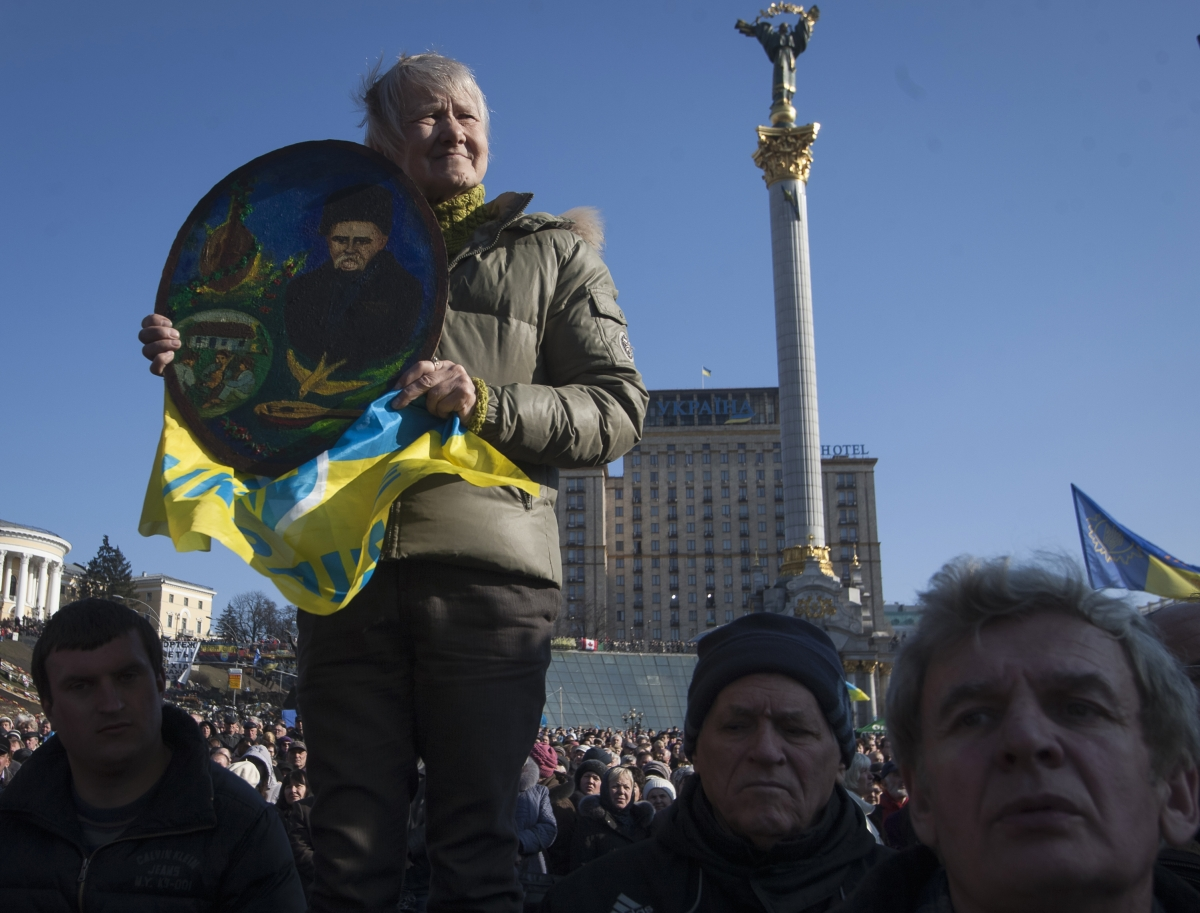 A woman holds up a portrait of poet Taras Shevchenko at a pro-Ukrainian rally in Kiev.