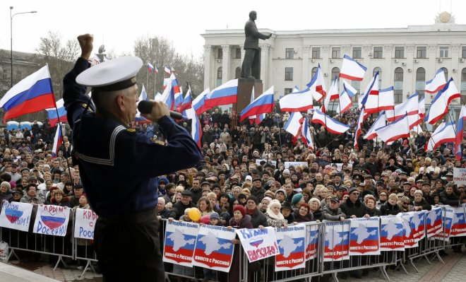 A member of Russia's Black Sea Fleet performs for the pro-Russian crowds in Simferopol, Crimea.