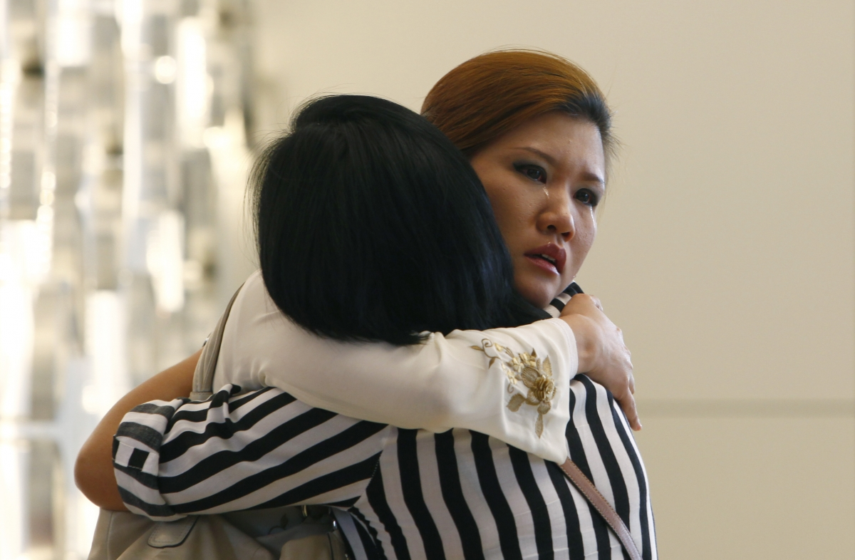 Relatives of a passenger onboard the missing Malaysia Airlines flight MH370 cry inside a hotel they are staying