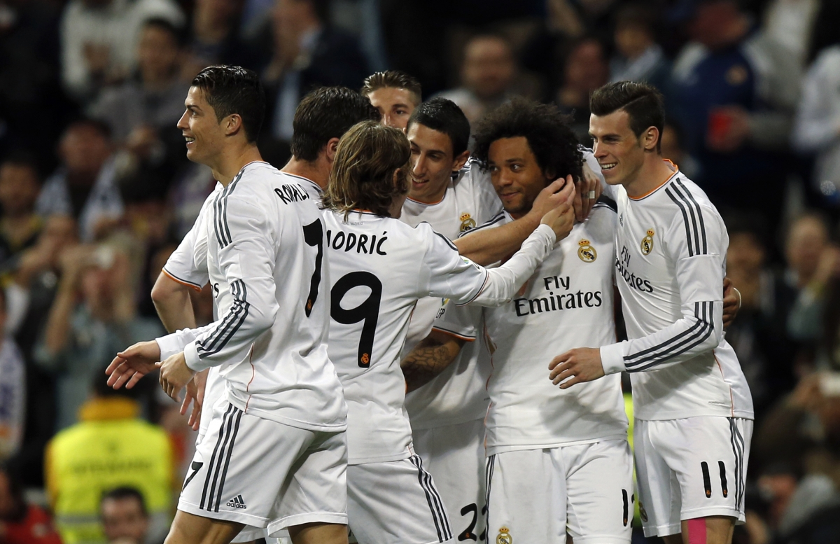Real Madrid's Marcelo is congratulated by teammates after scoring a goal against Levante.