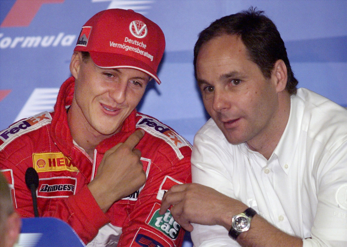 Gerhard Berger (r) and Michael Schumacher at a press conference at Melbourne's Albert Park Grand Prix circuit, in 2000