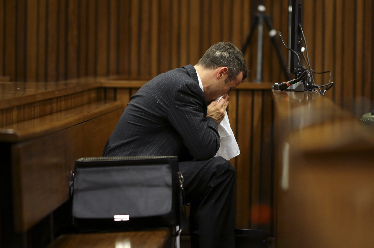Oscar Pistorius vomited repeatedly in to a bucket as Prof Gert Saayman described what 9mm Parabellum 'ranger' bullets did to Reeva Steenkamp