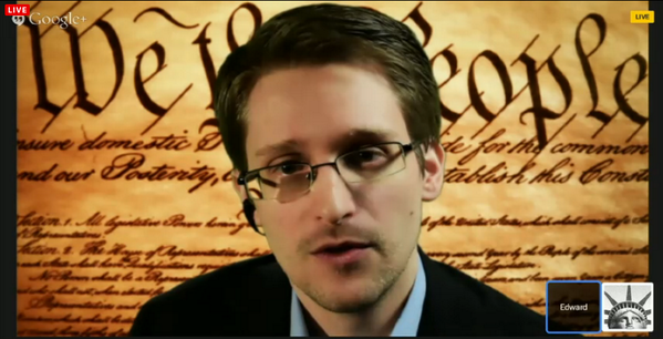 Edward Snowden stands in front of the First Amendment of the US Constitution