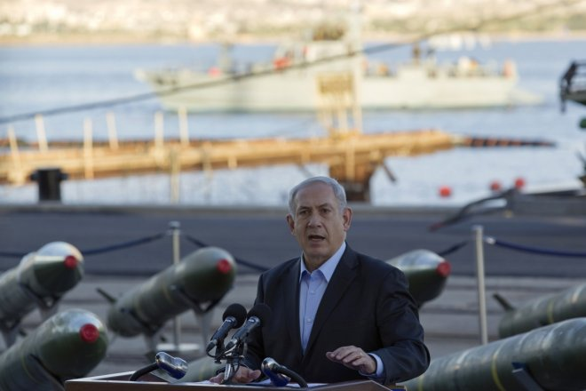 srael's Prime Minister Benjamin Netanyahu speaks to the media in front of a display of M302 rockets, found aboard the Klos C ship, at a navy base in the Red Sea resort city of Eilat
