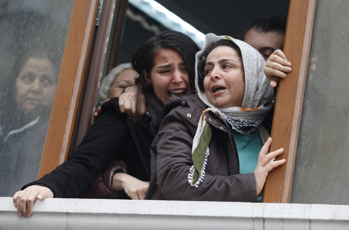 Berkin Elvan's sister Ozge (C) reacts as his coffin approaches the Okmeydani cemevi, an Alevi place of worship, in Istanbul