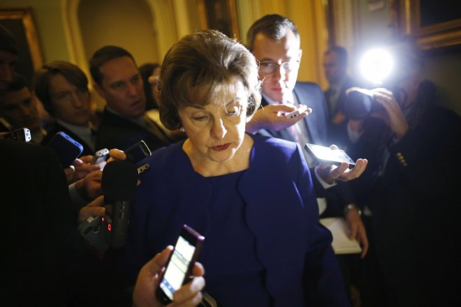 U.S. Senator Dianne Feinstein (D-CA) is trailed by reporters