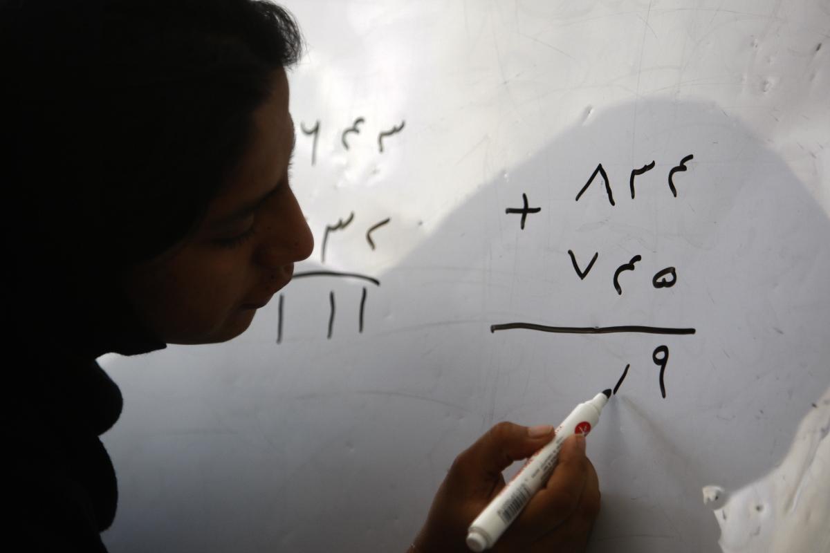 Afghan woman doing maths