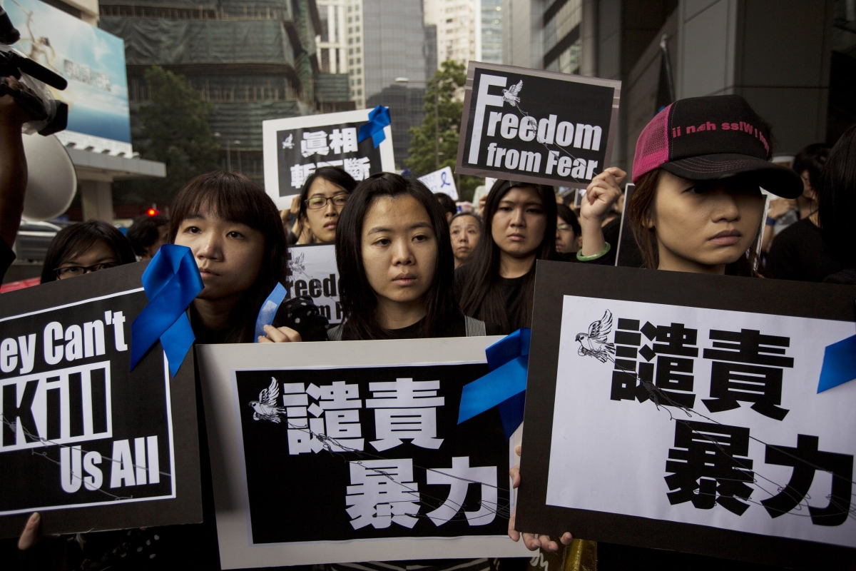 Staff members of Ming Pao newspaper take part in the march against violence on journalists in Hong Kong