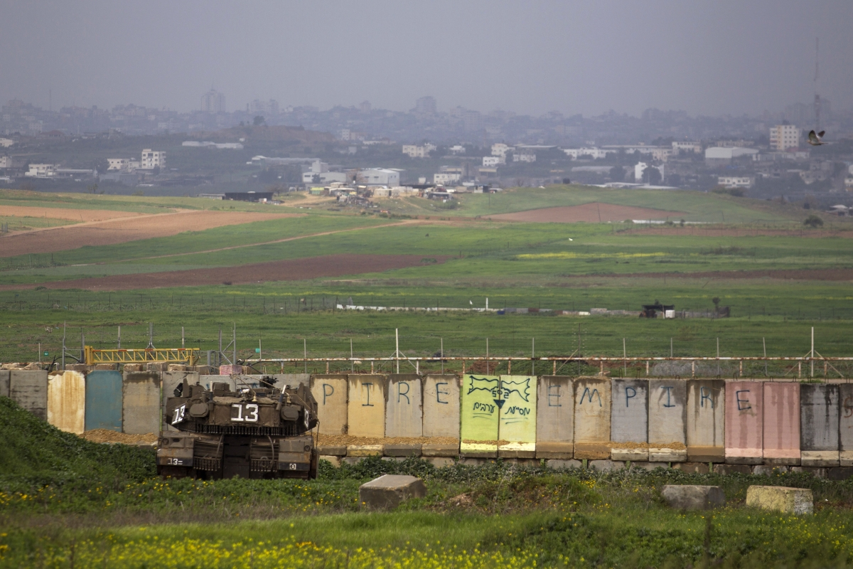 An Israeli tank is positioned outside the northern Gaza Strip